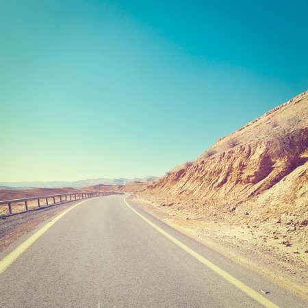 negev: Winding Asphalt Road in the Negev Desert in Israel