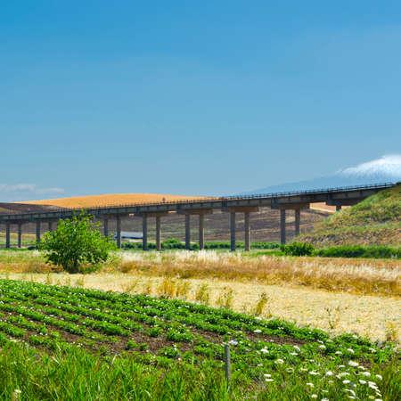Landscape of Sicily with Highway Bridge Stock Photo