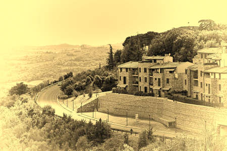Winding Asphalt Road near the Italian Town, Vintage Style Toned Picture
