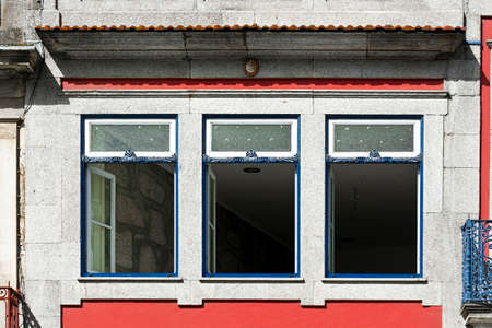 open windows: Open Windows of the Repaired Apartments of the Portuguese Home Stock Photo