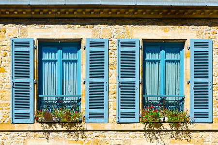 open windows: French Windows with Open Wooden Shutter Decorated with Fresh Flowers