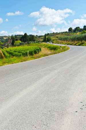 Italian Village near the Road Surrounded by Vineyards and Olive Groves Stock Photo