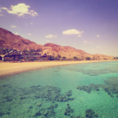 View to the Coastline of Red Sea from Coral Reef in Israel Stock Photo