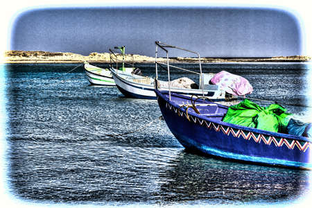 Small motor boats at the beach.  Fishing Boats moored in the mediterranean sea in Israel. Vintage Style Toned Picture Stock Photo