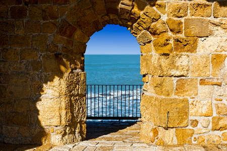 The city beach located adjacent to the sea walls of Akko in Israel. View on a fortification of an old city Akko, a small Israeli port town with ruins dating 4000 years
