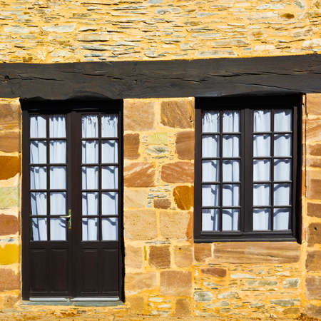 French Window and Door in Old Stone Wall