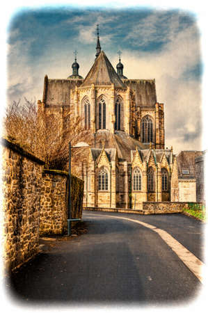 The street leading to the church in Belgium. Cathedral of St. Hubert in Belgium. Vintage Style Toned Picture