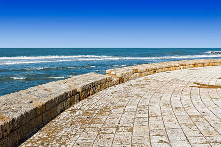 Promenade along the Mediterranean Sea in Akko. Embankment and city beach of old arabic city Akko, located north of Israel