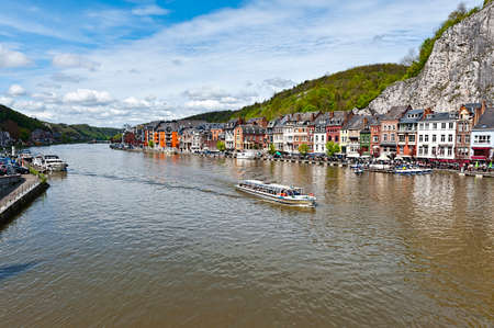 meuse: Embankment of the River Meuse in the Belgian City of Dinant. Beautiful small town Dinant in Belgium. Stock Photo