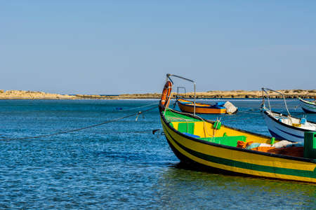 Small motor boats at the beach.  Fishing Boats moored in the mediterranean sea in Israel Stock Photo