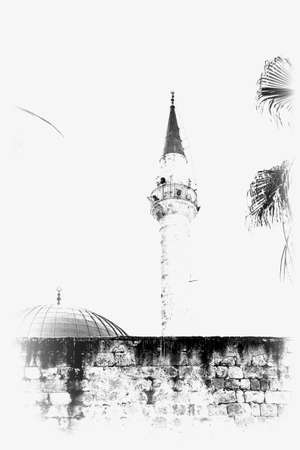 Sinan Pasha Mosque with dome in the old town of Acre, Israel. Muslim mosque and minaret in the old city of Akko. Black and white picture