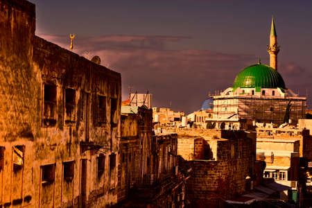 Restoration of Muslim mosque in the old city of Akko at sunset. Al-Jazzar mosque as fine example of the Ottoman architecture in old Acre, Israel. Stock Photo