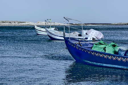 Small motor boats at the beach.  Fishing Boats moored in the mediterranean sea in Israel at Night Stock Photo