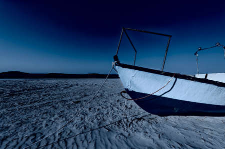 Fishing boat on the beach of the Mediterranean sea in Israel at night Stock Photo