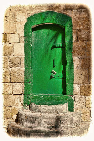 Metal door in the old city of Akko in Israel.  Traditional Arabic style for doors in old Acre. Vintage style toned picture
