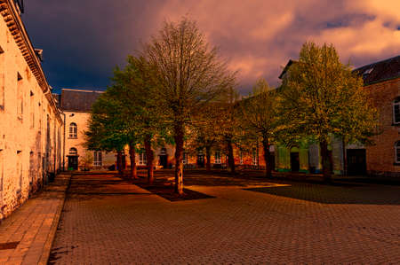 Patio of the Belgian house with park. The old pavement in St Hubert, Belgium at sunset. Stock Photo
