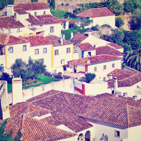 tiling: View to Historic Center City of Obidos in Portugal,