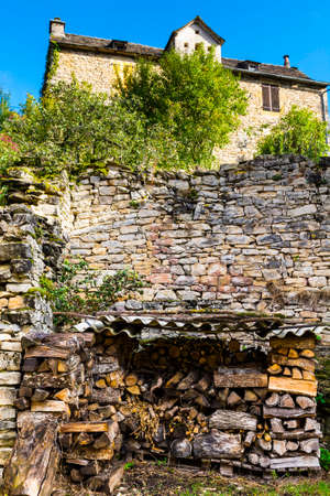 Sawed firewood dropped in a pile in the medieval city of Auxillac in France. Auxillac is a commune in the Lozere department in the Languedoc-Roussillon region in southeastern France.