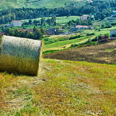 Hay Bale on the Background of the Sicilian village