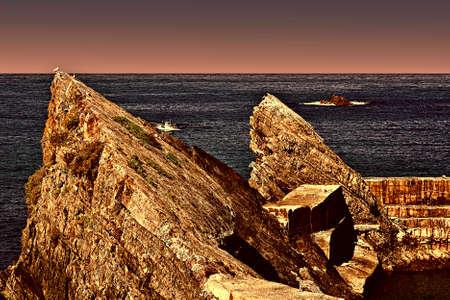 Fishing Schooner Entering the Quiet Harbor on the Atlantic Coast of Portugal at Sunset