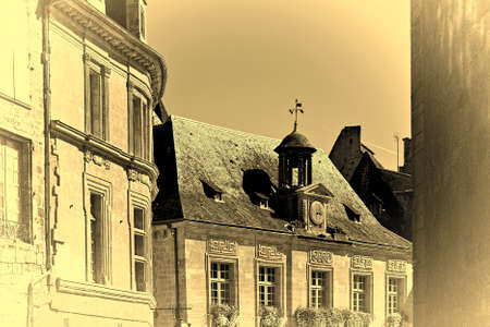 shutter: Black Tiles on the Peaked Roofs in French City of Sarlat, Stylized Photo Stock Photo