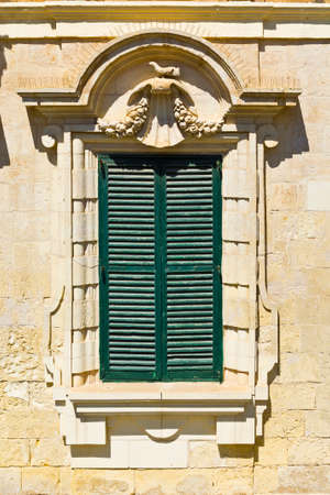 shutter: Building with traditional maltese window in historical part of Valletta.