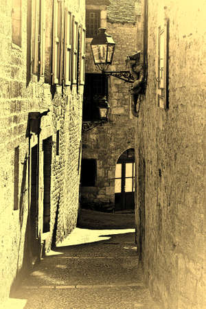 street lamp: Narrow Street in French City of Sarlat, Stylized Photo