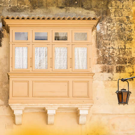 balcony: Building with traditional colorful maltese balcony in historical part of Mdina. The city was founded as Maleth in around the 8th century BC by Phoenician settlers on the island of Malta