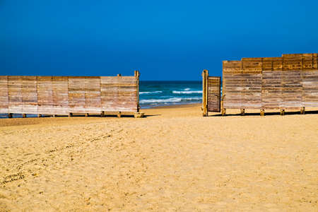 Wooden plank fence in the Israeli shore of the Mediterranean Sea. The wall separating the male and female religious part of the beach in Israel Stock Photo