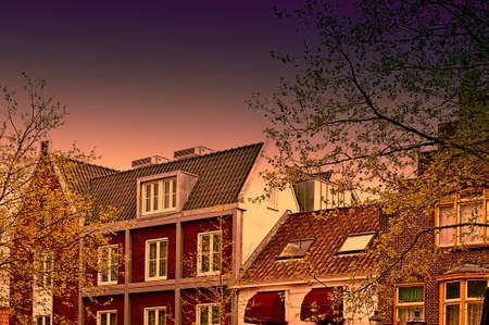 Historic buildings in the city of Amersfoort at sunset. Typical Dutch brick houses in Holland.