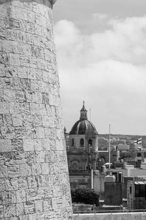 Victoria also known among the native Maltese as Rabat on island Gozo. View from Citadel to baroque Cathedral. Black and white picture