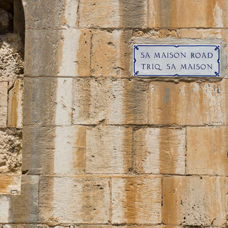 old english: Street sign in the city of Mdina that was founded as Maleth in around the 8th century BC by Phoenician settlers on the island of Malta. Stock Photo