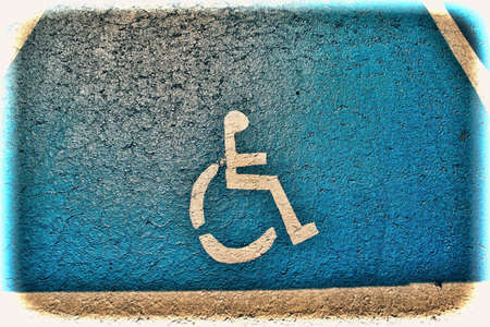 Parking for disabled people in Tel Aviv. Asphalt painted parking lot sign for people with wheelchair in Israel. Vintage style toned picture Stock Photo