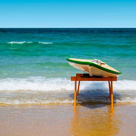 Hawaiian surfboard on the beach of the Mediterranean sea in Israel Stock Photo