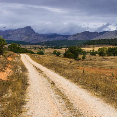 Winding dirt road of Europe Peaks in Spain on a rainy day Stock Photo