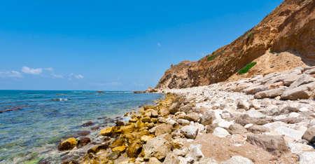 Israeli shore of the Mediterranean Sea. Rocky beach in Israel