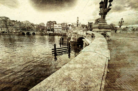Bridge in Amsterdam with typical local architecture. Embankment in the historical center of Amsterdam in the Netherlands. Vintage style toned picture Archivio Fotografico