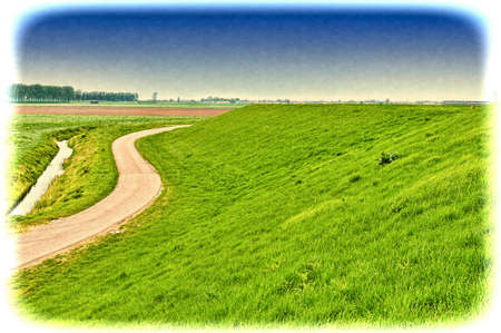 Agriculture on Land Reclaimed from the See in Netherlands. Asphalt road along protective dam and canal in Holland Stock Photo