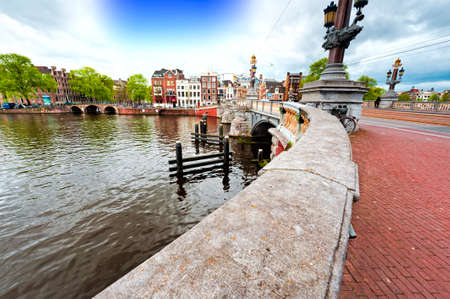 Bridge in Amsterdam with typical local architecture. Embankment in the historical center of Amsterdam in the Netherlands