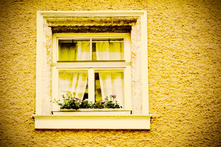 Typical windows of a house in a small town in Austria. Home in the Austrian city of Gmunden in a rainy day. Retro style Banque d'images