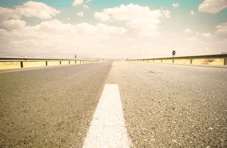 Empty asphalt road in the Jordanian valley in Israel. Retro style