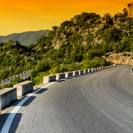 Winding Asphalt Road in the Cantabrian Mountains in Spain at sunrise. Breathtaking landscape and nature of the Iberian Peninsula Stock fotó - 133244299