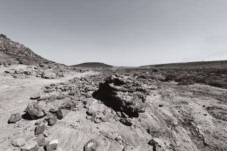 Rocky hills of the Negev Desert in Israel. Breathtaking landscape and nature of the Middle East. Black and white photo