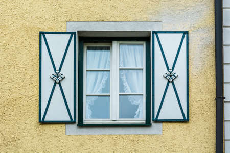 Typical window of a house in a small town in Austria. Home in the Austrian city of St Wolfgang in a rainy day. Retro style Stock fotó