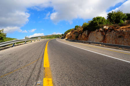 Empty asphalt road in the North Galilee in Israel. Standard-Bild