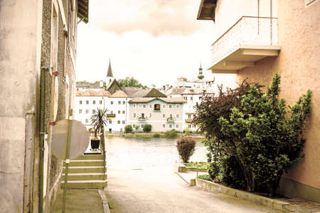 Traditional Austrian medieval architecture in the city of Gmunden. Embankment of the Traun River in Austria. Retro style