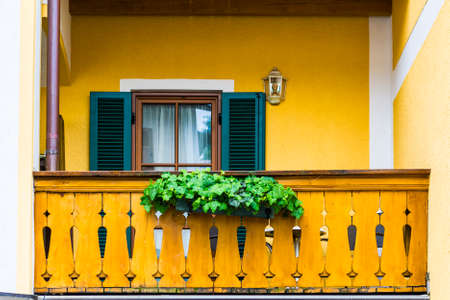 Typical window of a house in a small town in Austria. Home in the Austrian city of St Wolfgang in a rainy day.