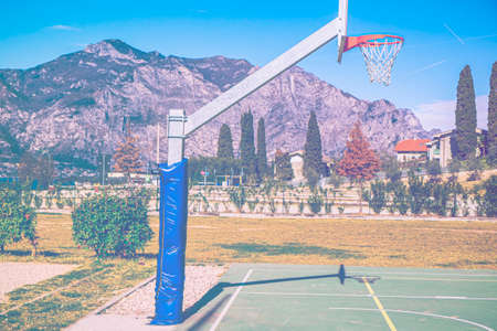 Deserted sports field on the shores of Lake Garda in Italy in faded color effect. Stock fotó
