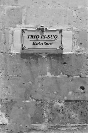 Street sign in the city of Mdina that was founded as Maleth in around the 8th century BC by Phoenician settlers on the island of Malta. Black and white picture 写真素材