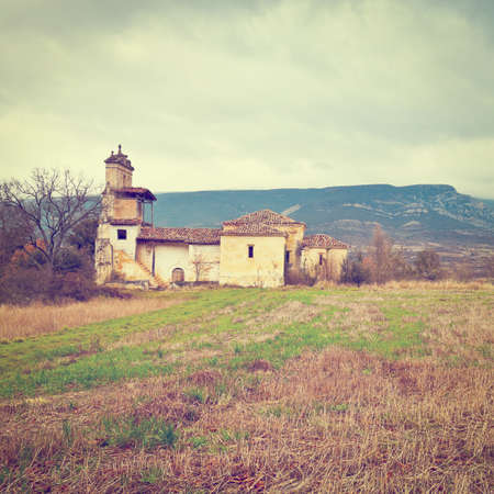 Medieval Spanish Church Surrounded by Fields in the Rainy Weather